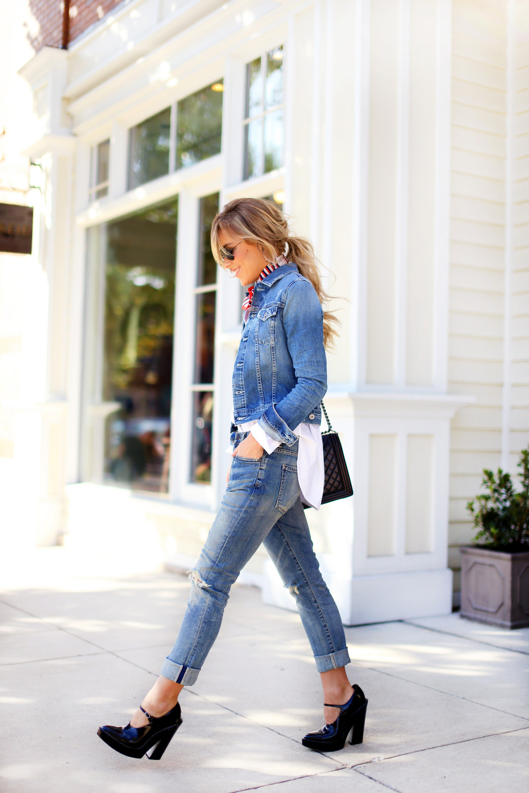 Mary Seng is wearing a denim jacket from AG Jeans, jeans from Citizens of Humanity, shoes from Alexander Wang, vintage scarf and the bag is from Chanel