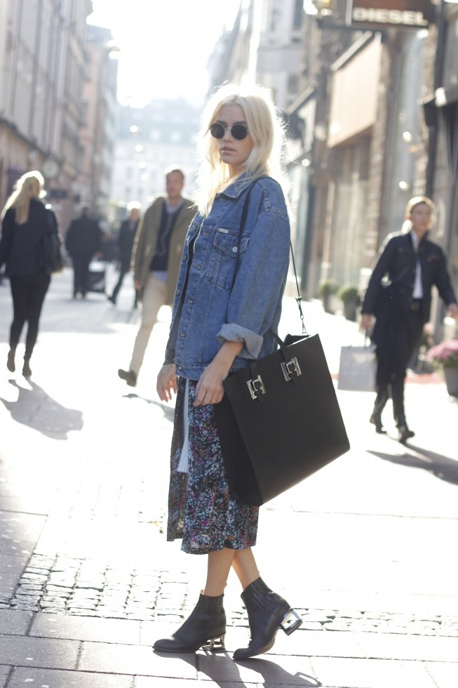 Elsa Ekman is wearing an oversized vintage denim jacket, floral kimono from River Island, white skirt from MissGuided and the ankle boots are from Skor Jeffery Campbell
