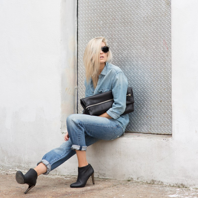 Figtny is wearing a thrift jeans from Paradise Mine, clutch from Six Eleven, boyfriend denim shirt from TNA and black ankle boots