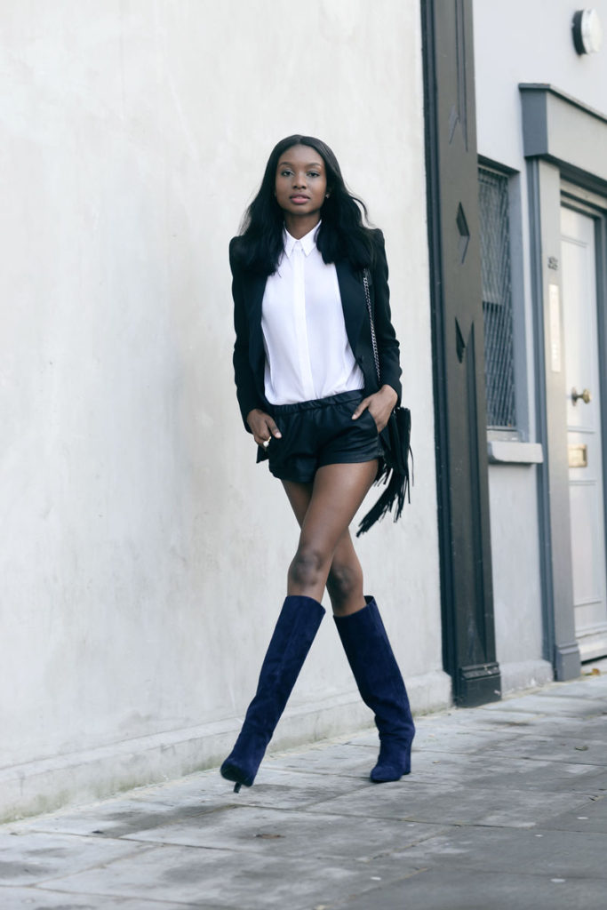 Natasha Ndlovu is wearing a black blazer from Zara, white shirt and shorts from Asos, faux suede tassel bag from TopShop and the suede wedge knee boots from Jimmy Choo