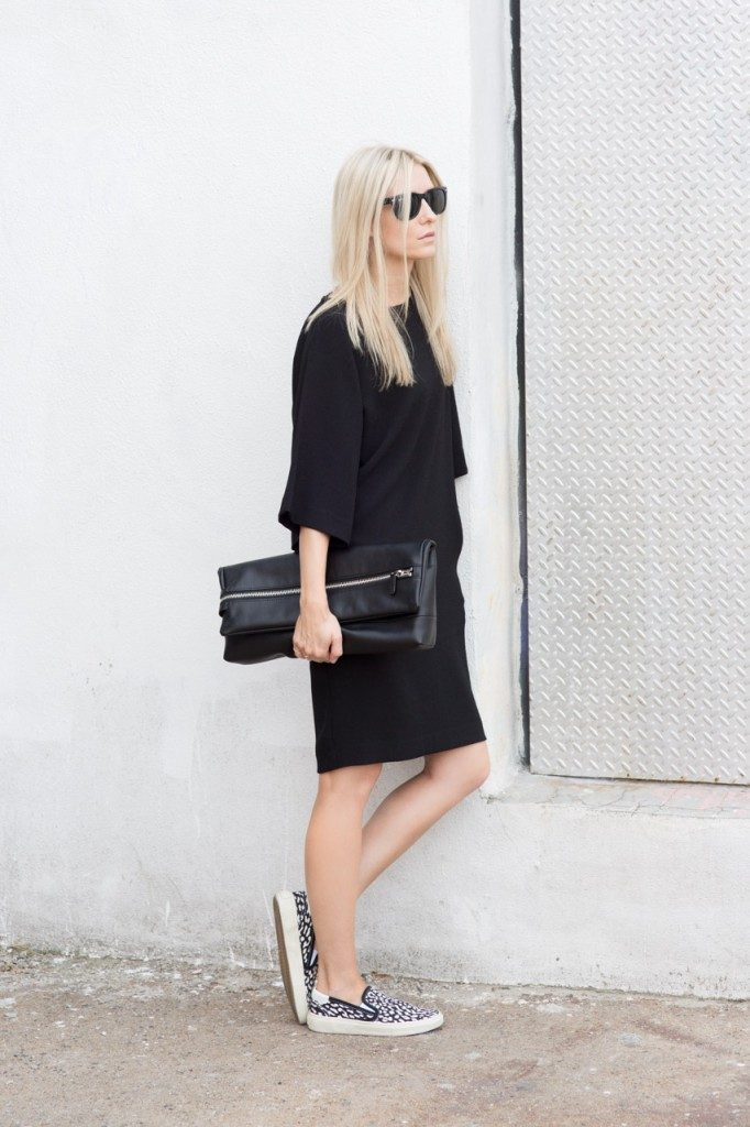 Figtny is wearing a black dress by BC, leopard print shoes from Saint Laurent and the clutch is from Aritzia