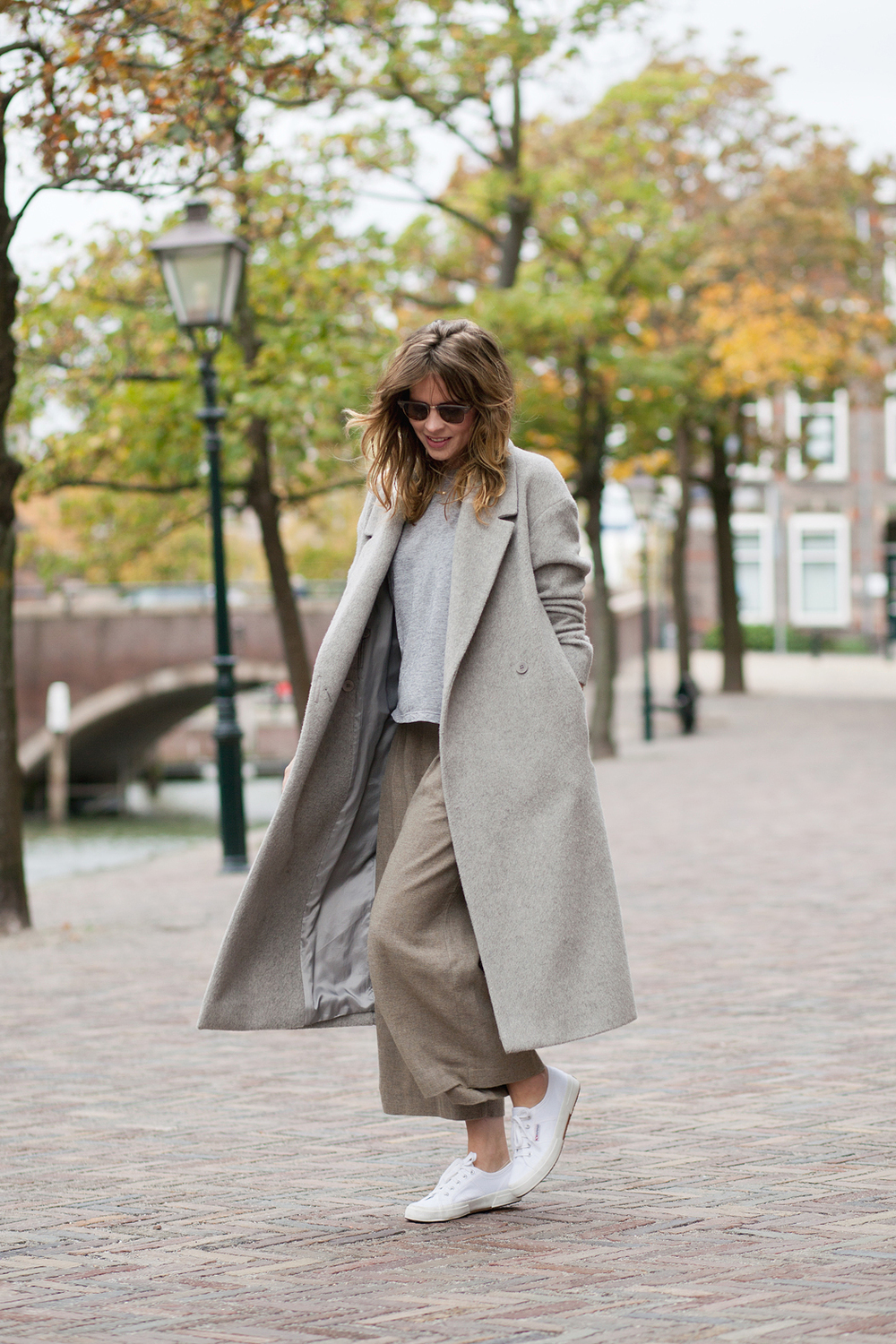 Christine R. is in a light grey long coat from COS