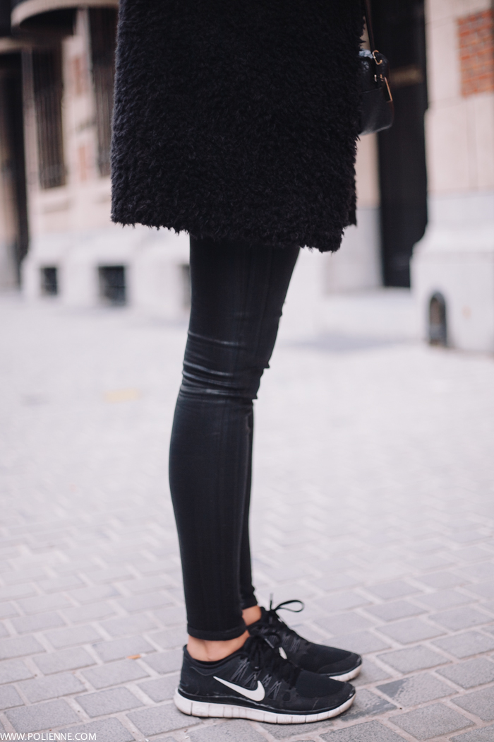 Paulien Riemis is wearing a black fuzzy coat from Pinko, black jeans from Citizens of Humanity and sneakers from Nike