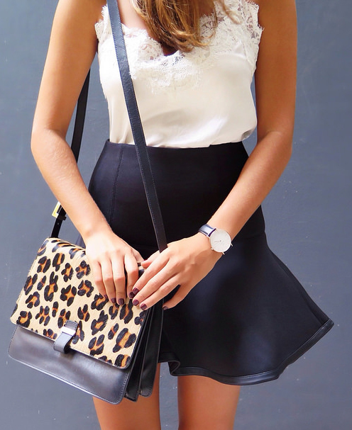 Geneva Vanderzeil in her leopard print bag from Whistles, black leather trim skirt from Club Monaco and the white lace trim top is from Witchery