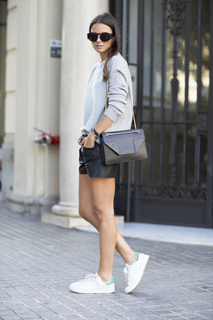 Zina Charkoplia is wearing a pale grey wool and cashmere sweater from Jil Snader and the bag is from Saint Laurent