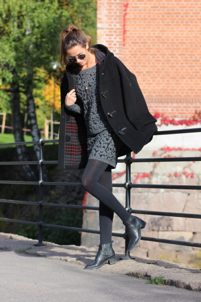 Benedichte is wearing a duffle coat with plaid hem from GloverAll and ankle boots from Camilla Pihl For Bianco
