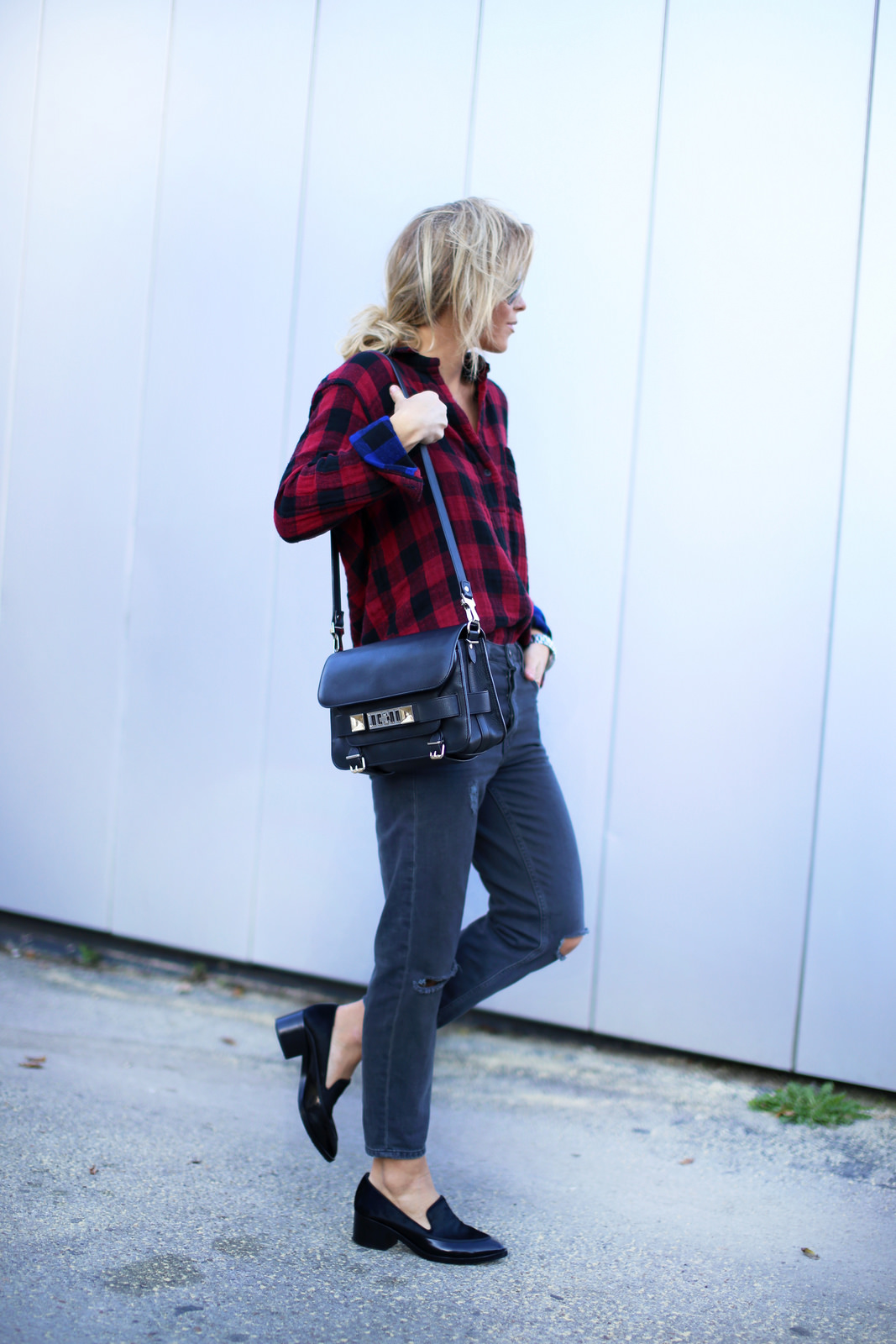 Mary Seng is wearing a buffalo plaid shirt from Rag & Bone