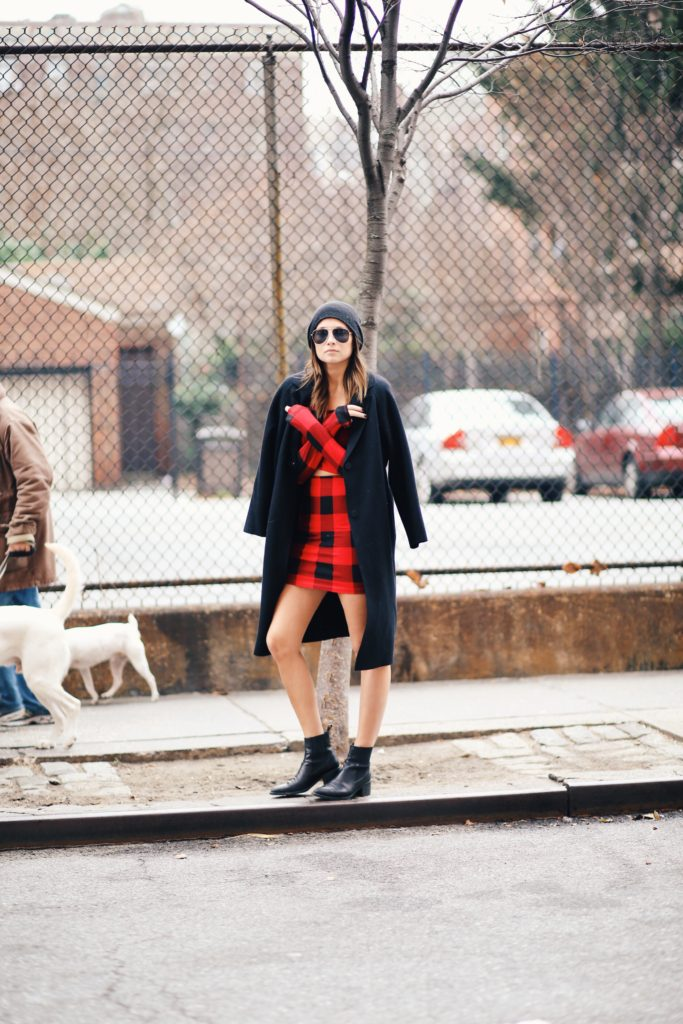 Danielle Bernstein is wearing a buffalo plaid top and skirt from Gypsy Warrior
