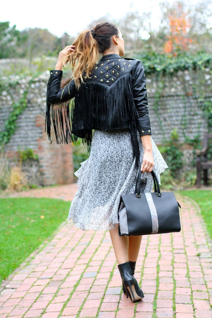 Tamara Kalinic is wearing a star embellished fringe leather jacket from Choies