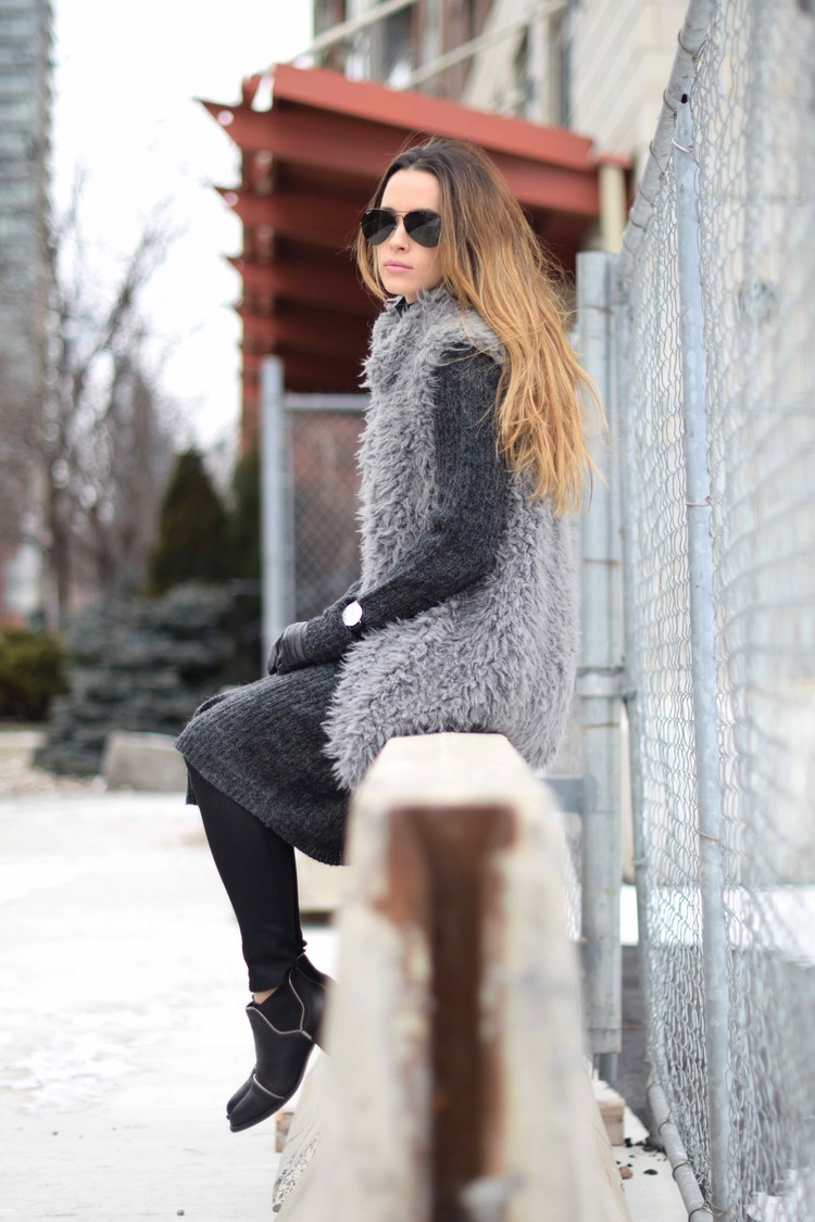 Jodi Black is wearing a furry grey shearling vest from Forever 21