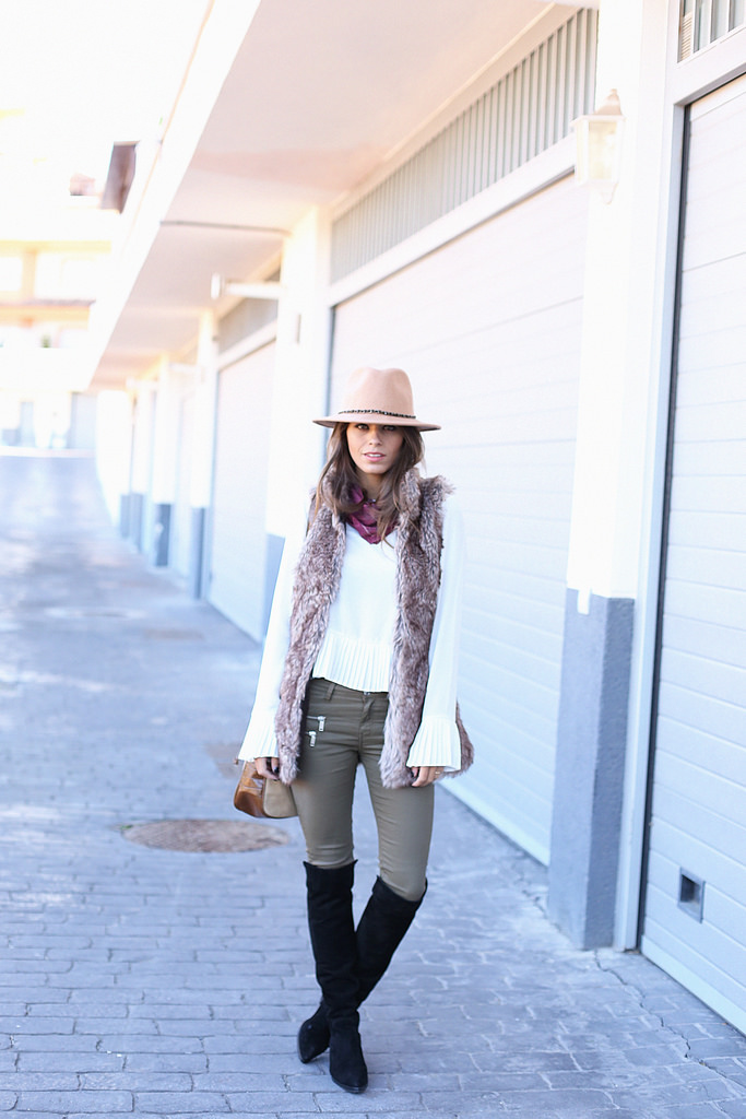 Jessie Chanes is showing us how to style a faux fur vest. This particular one is from Buyleward