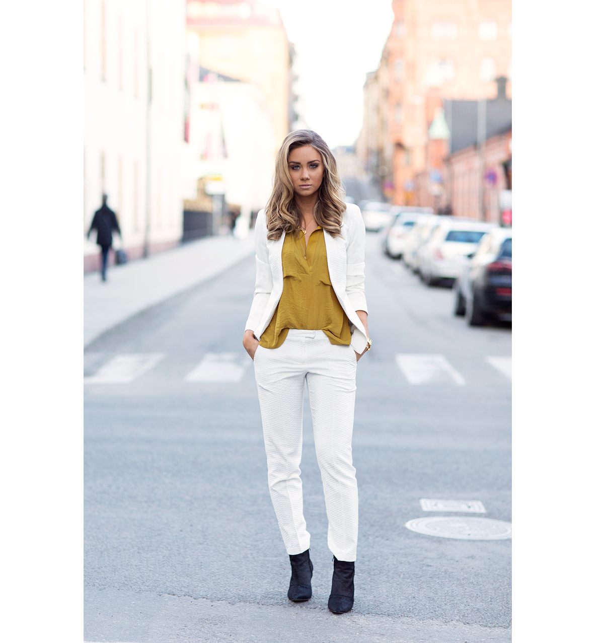 Lisa Olsson is wearing a mustard yellow H&M shirt