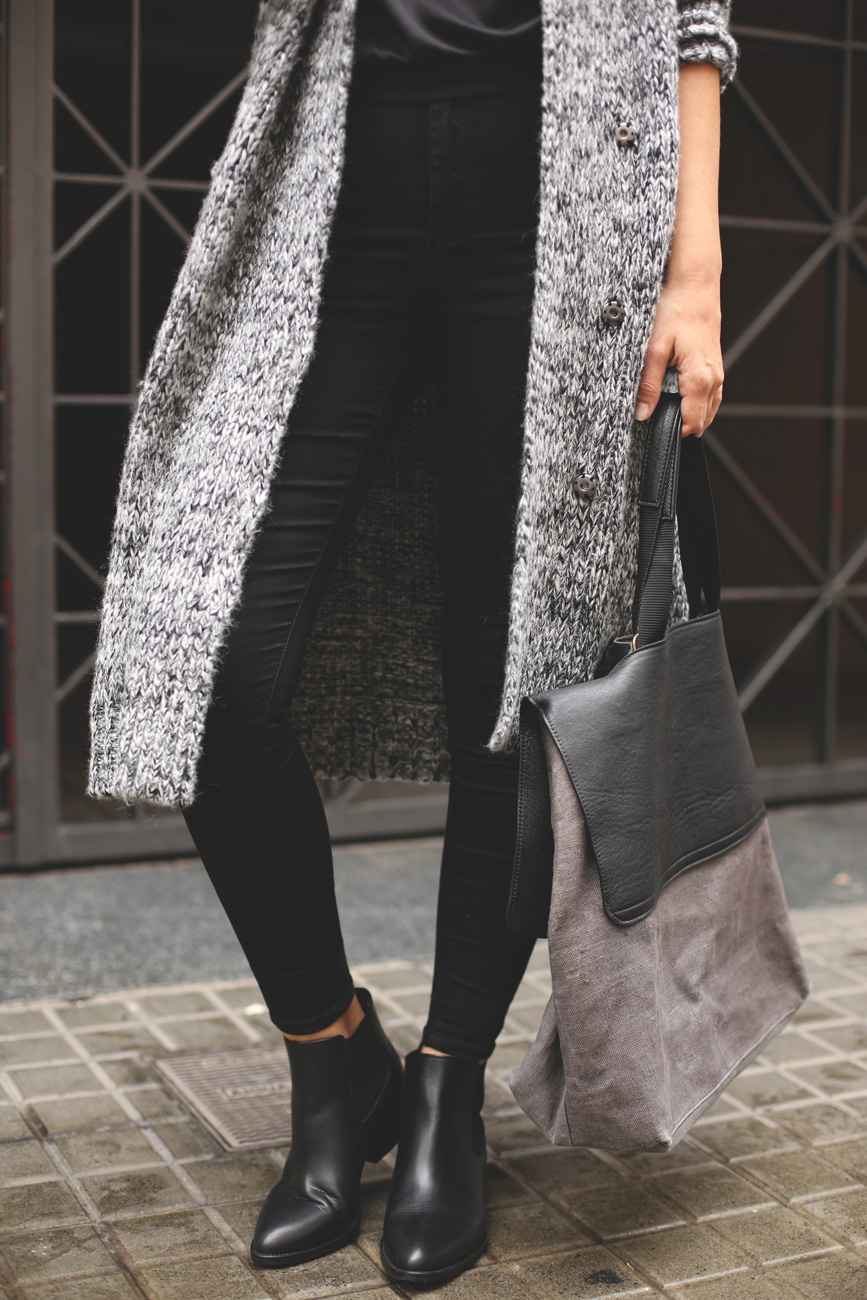 Priscila Betancort is wearing a grey coat from Chicwish, sweatshirt from New Talent and boots from TopShop