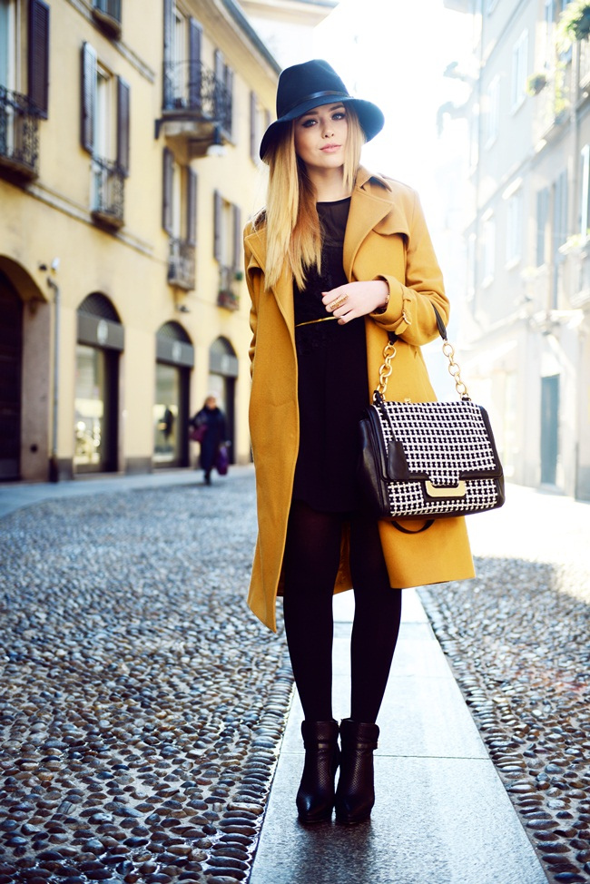 Kristina Bazan is wearing a mustard yellow coat from Zalando