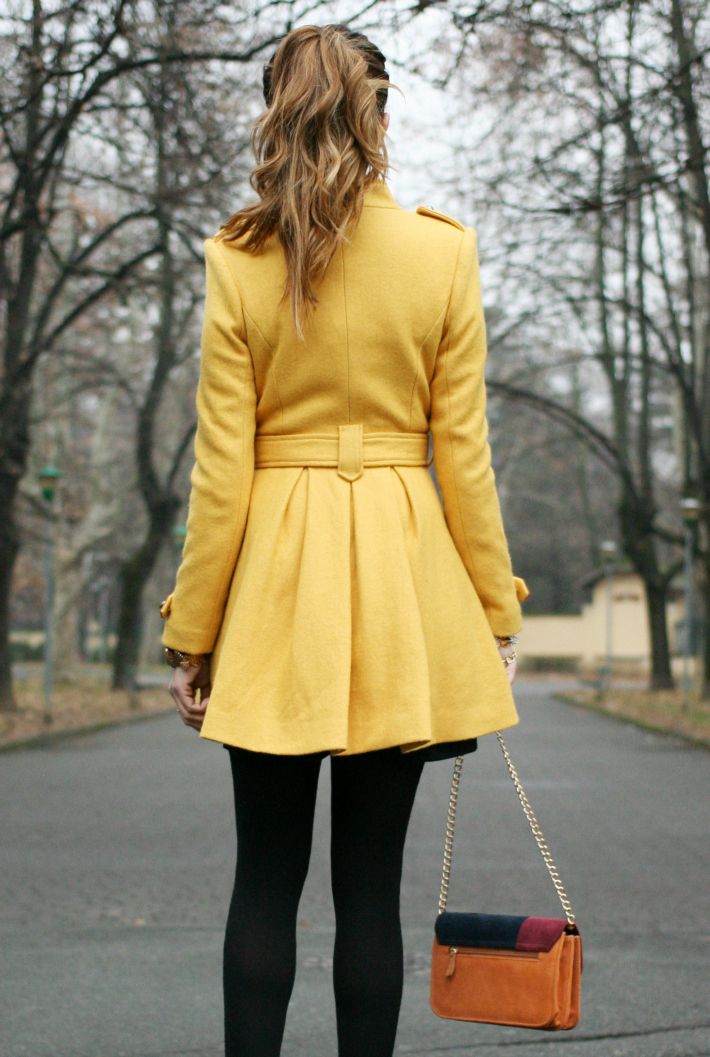 Nicoletta Reggio is wearing a mustard coloured coat