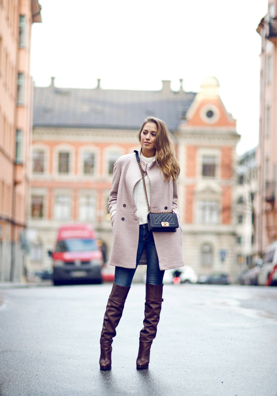 Kenza Zouiten is wearing brown above the knee boots from H&M