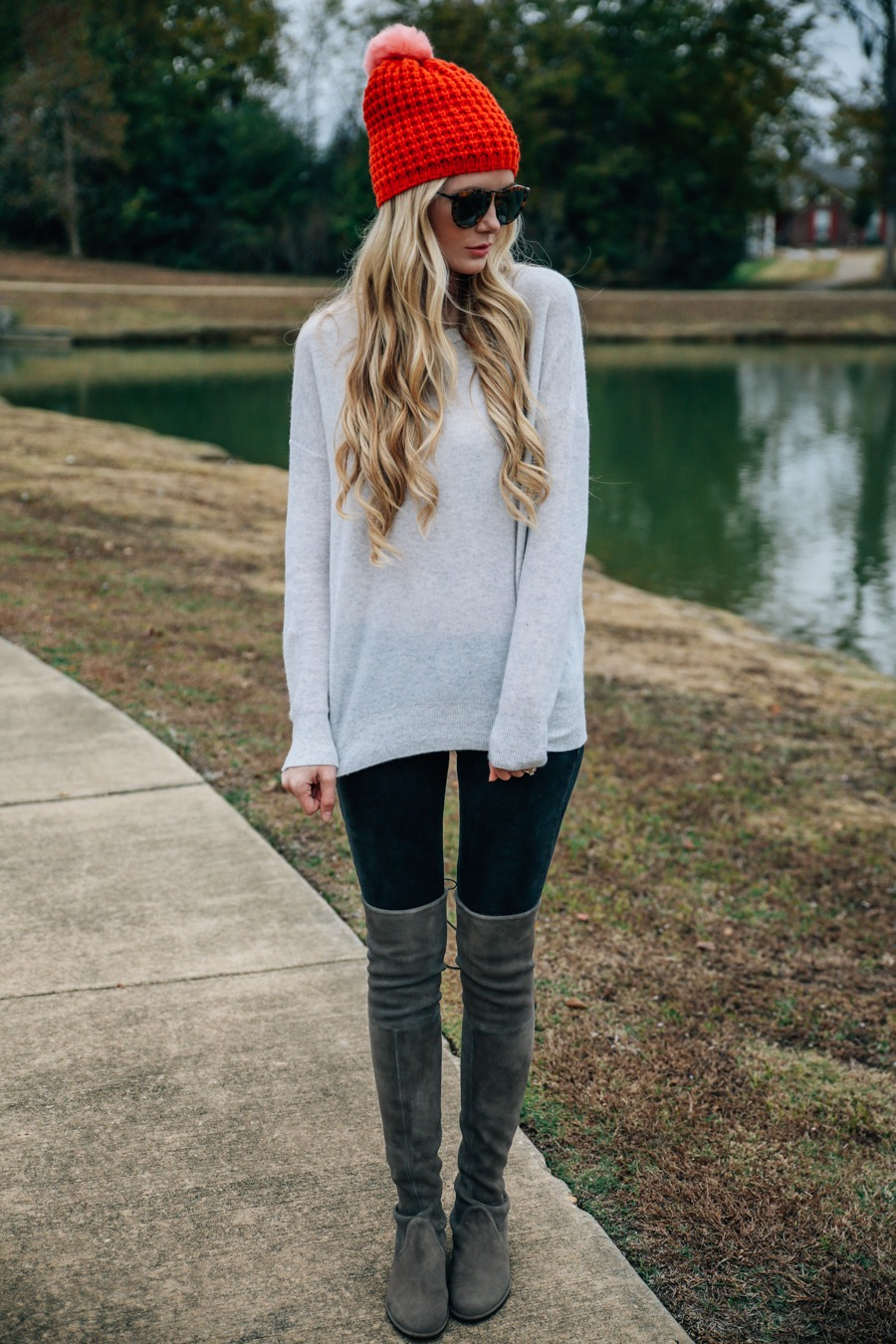 Over-The Knees Trend: Amber Fillerup Clark is wearing her praline over-the-knee boots from Stuart Weitzman