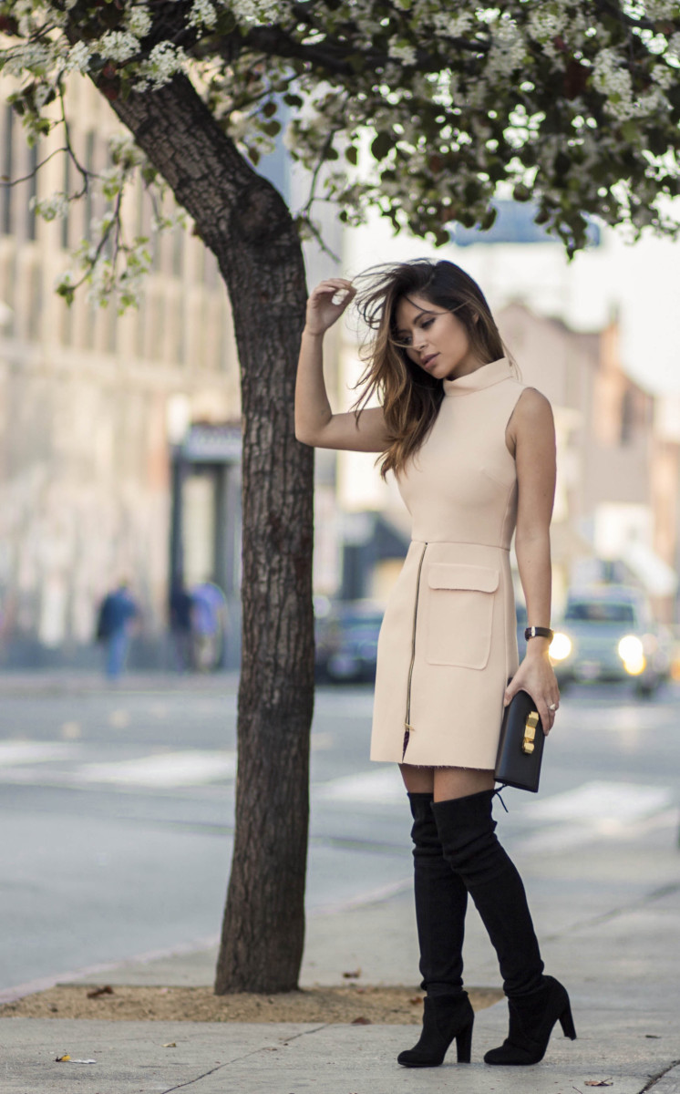 Over The Knee Boots Trend: Marianna Hewitt is wearing black suede highland boots from Stuart Weitzman