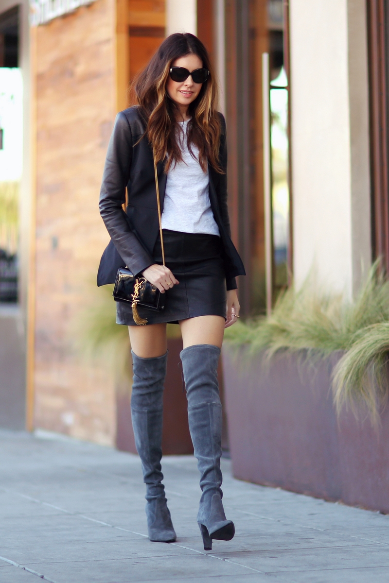 Erica Hoida is wearing dark grey over the knee boots from Stuart Weitzman