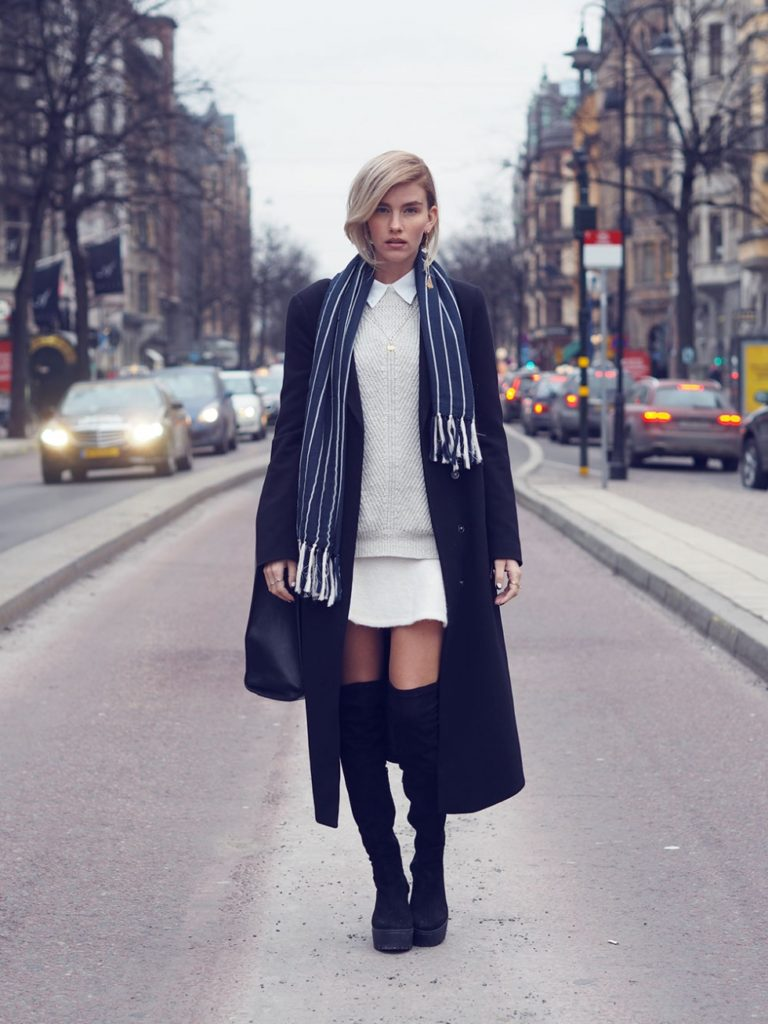 Elsa Ekman is wearing over the knee boots and skirts from River Island