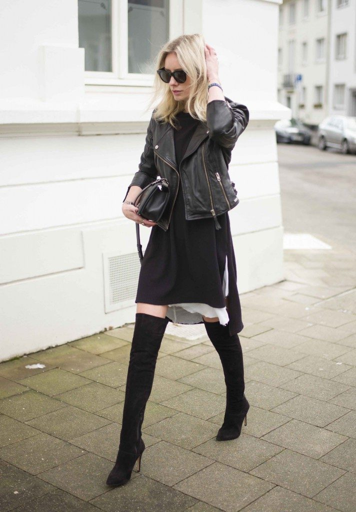 Lisa RVD is wearing all black, over the knee boots and dress from Office and Boris Bidjan Saberi respectively
