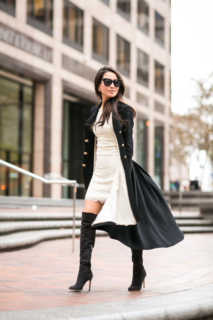 Wendy Nguyen is wearing a black over-the-knee-boots from Gianvito Rossi