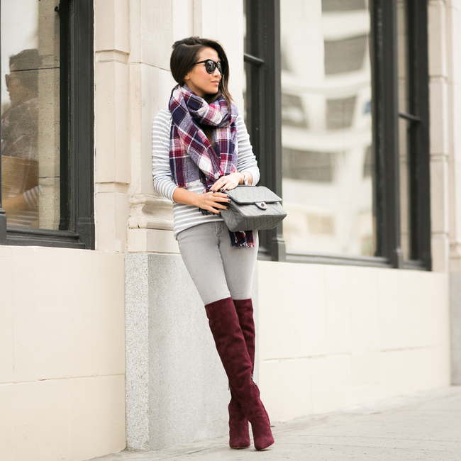 Wendy Nguyen is wearing burgundy over the knee boots from Joie