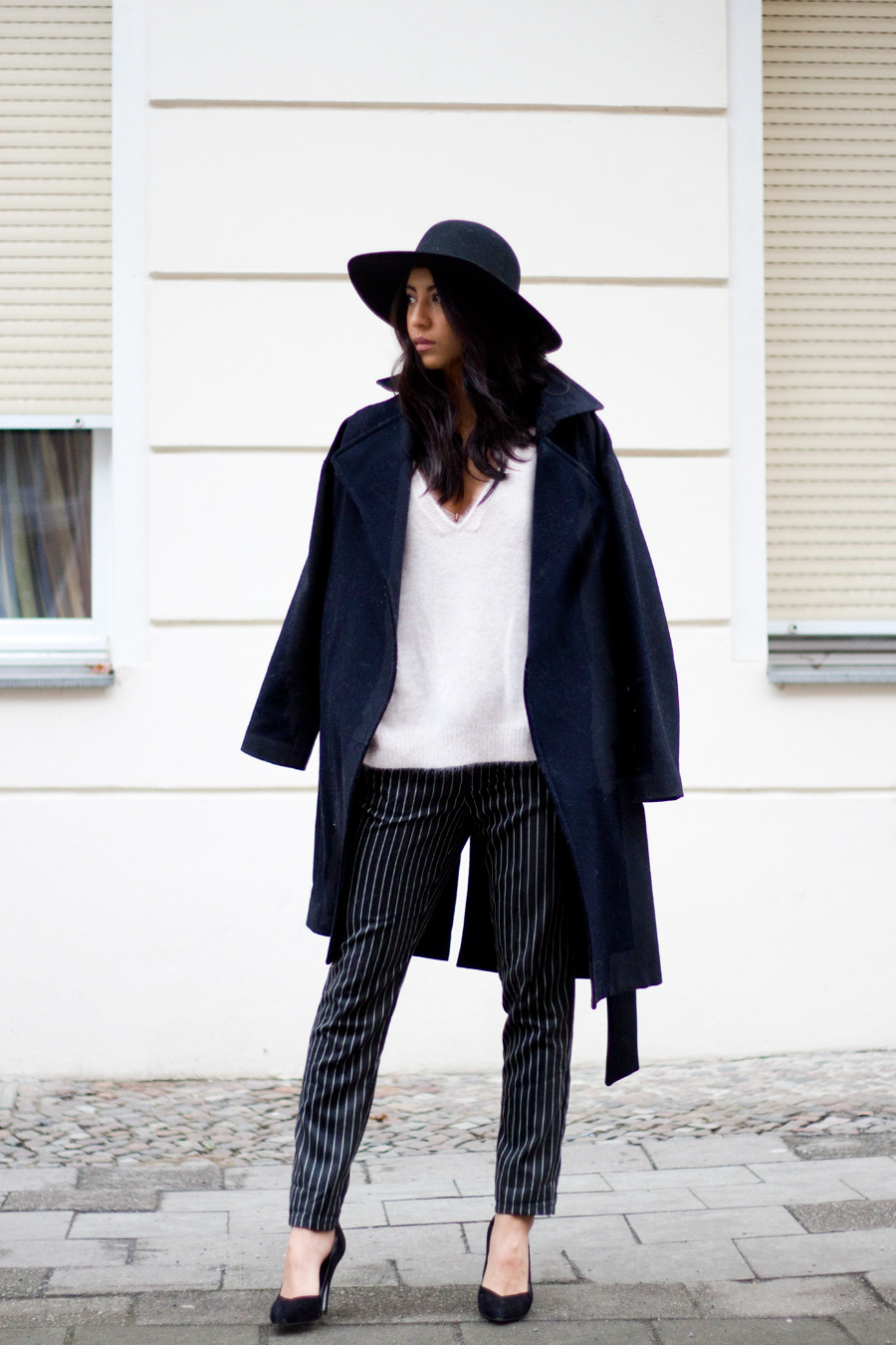 Pinstripe Outfits: Kayla Seah is wearing Alistair pinstripe trousers from Free People