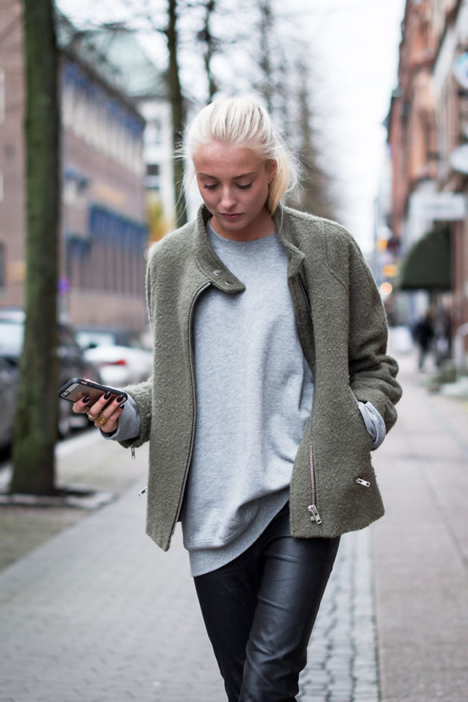 Ellen Claesson in her light grey sweater from Blk Denim, military green jacket from Zara and black leather pants from COS