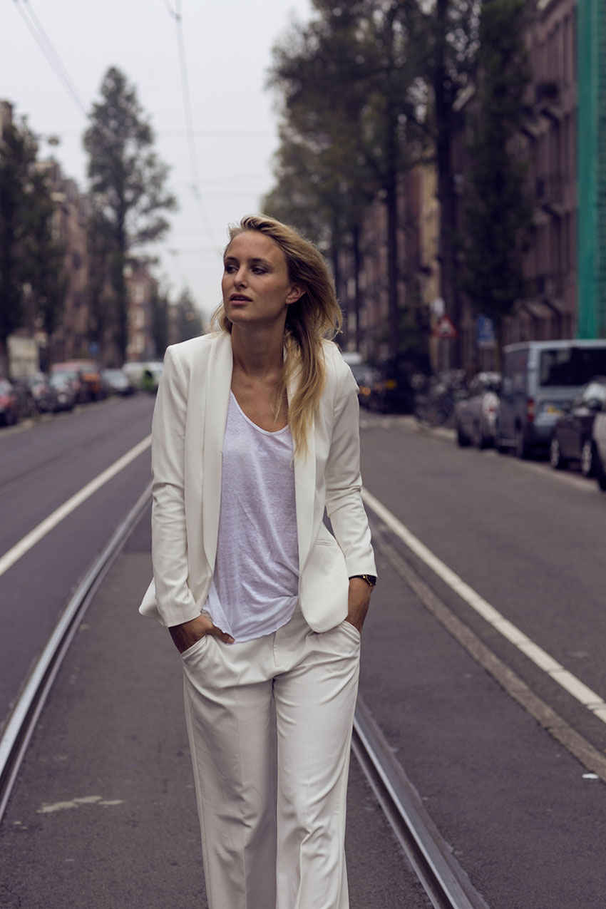 Rebecca Laurey in a white suit designed by Camille Charriere for Pimkie