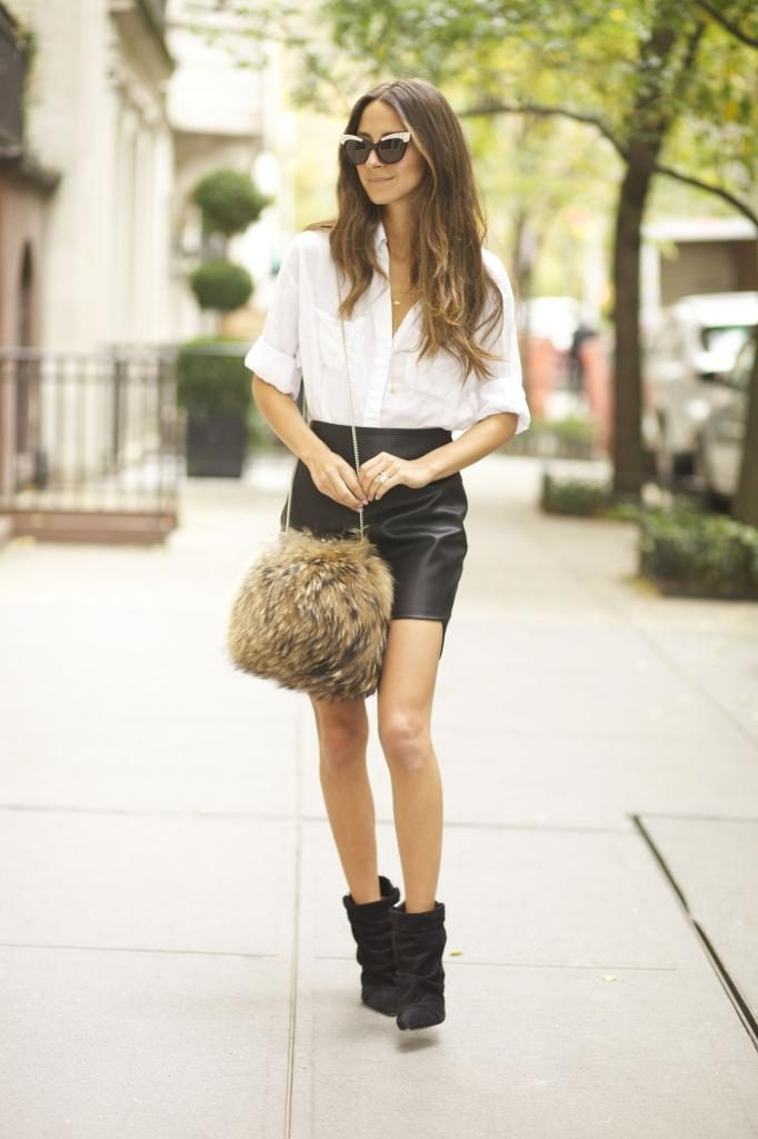 Arielle Nachami is wearing a leather skirt from Coverii, white shirt from Elizabeth and James, boots from Isabel Marant, the fluffy bag is fromTheory and the Sunglasses are from Wildfox