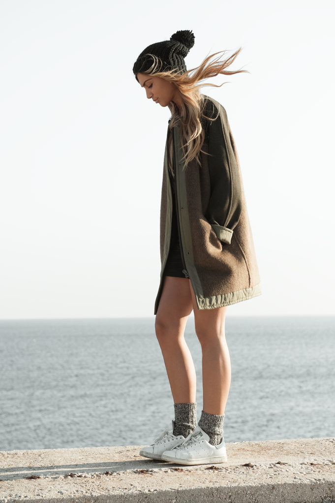 Natalia Georgala is wearing a khaki coat from Isabel Marant, sneakers from Adidas and the beanie is from Zara