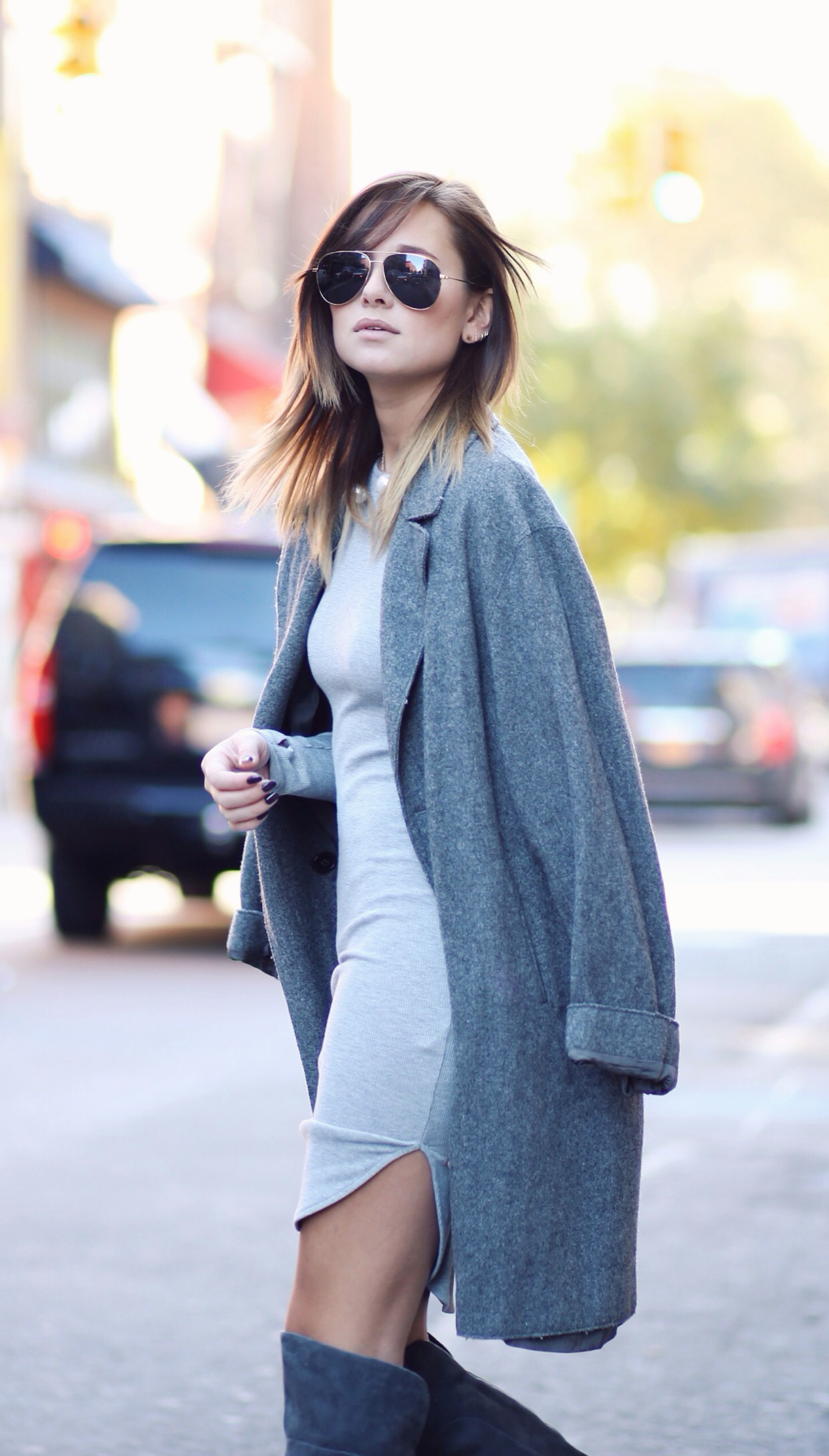 Danielle Bernstein is wearing grey on grey, dress from H&M and the coat is from Jil Sander