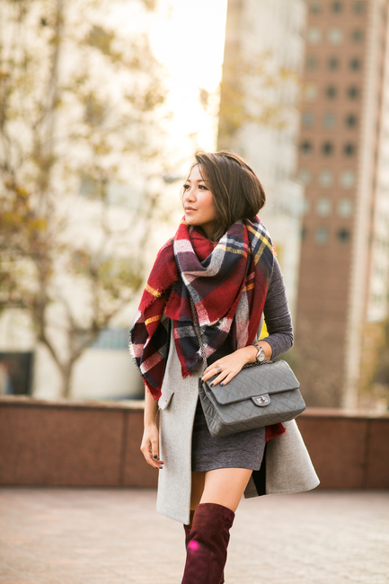 Just The Design: Wendy Nguyen is wearing a pale grey vest from Intermix, grey dress from from T by Alexander Wang, matching bag from Chanel, burgundy boots from Joie and the scarf is from Zara