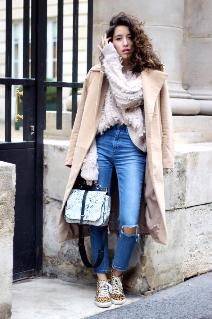 Alexandra Guerain is wearing a coat from MissGuided, fluffy jumper from Theory, ripped jeans from Asos, shoes from Asos and the bag is from Florian Denicourt