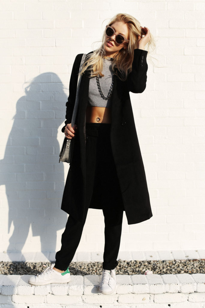 Shea Marie is wearing a black coat from Forever 21, trousers from A.L.C., shoes from Adidas, bag from Barbara Bui and the jumper from Thakoon