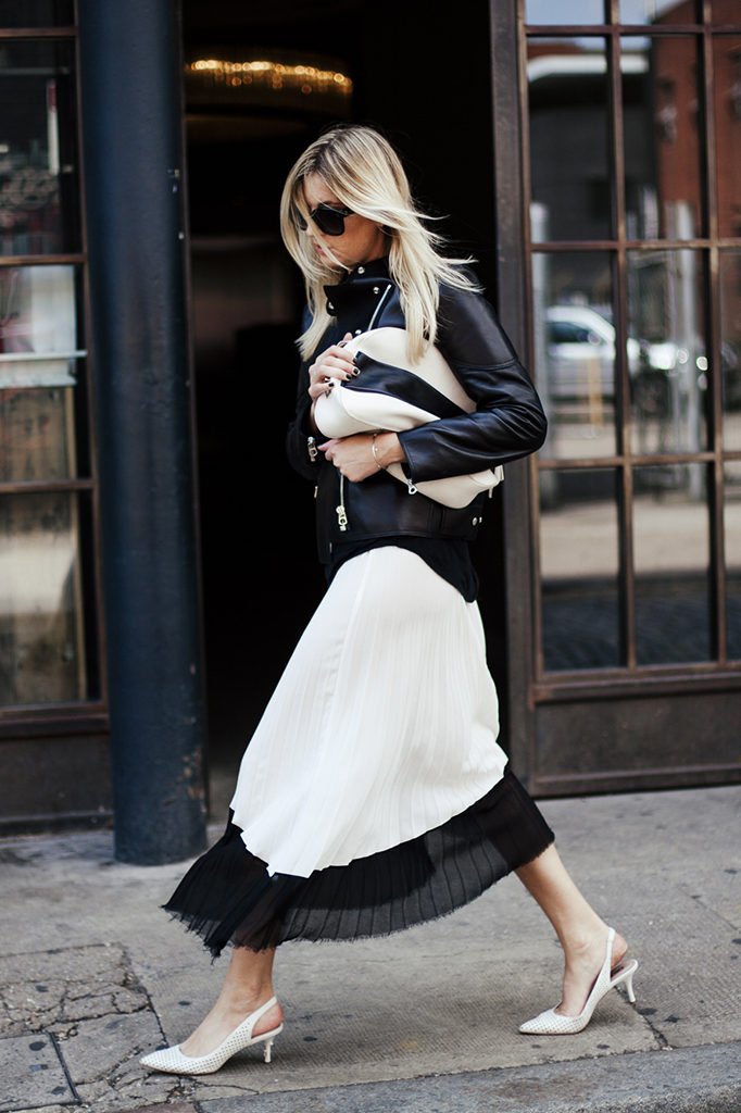 Camille Charriere is wearing a jacket from Sandro, black and white skirt from Zara, shoes from DKNY and the clutch is from Sportmax