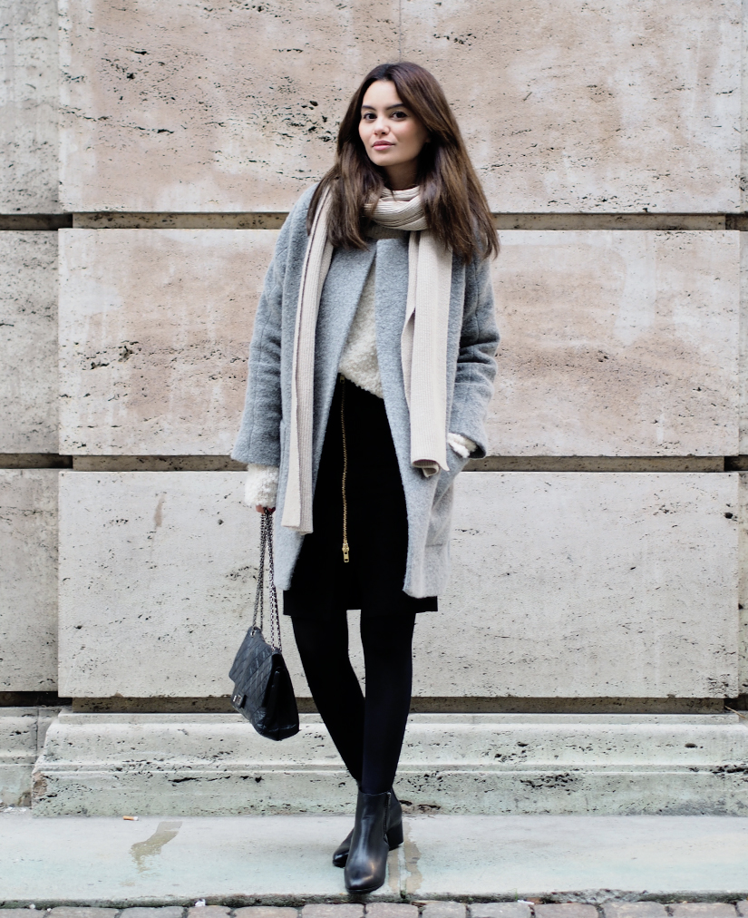 Funda Christophersen is wearing a grey coat from Sand, jumper from Ganni, scarf from Toteme, black skirt from Envii, bag from Chanel and the ankle boots are from Opening Ceremony