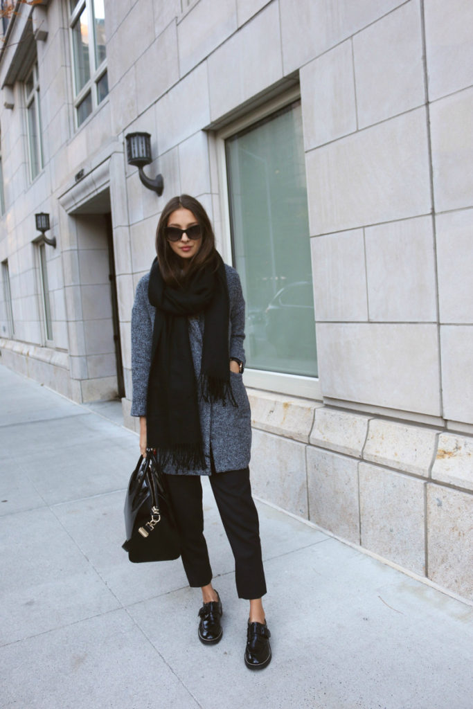 Felicia Akerstrom is wearing a grey long coat from Sheinside, trousers, scarf and bag from Topshop and shoes from Givenchy