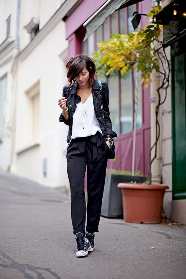Zoé Alalouch is wearing a jacket and bag from Zara, top from Monoprix, trousers from Mango and the sneakers are from Converse