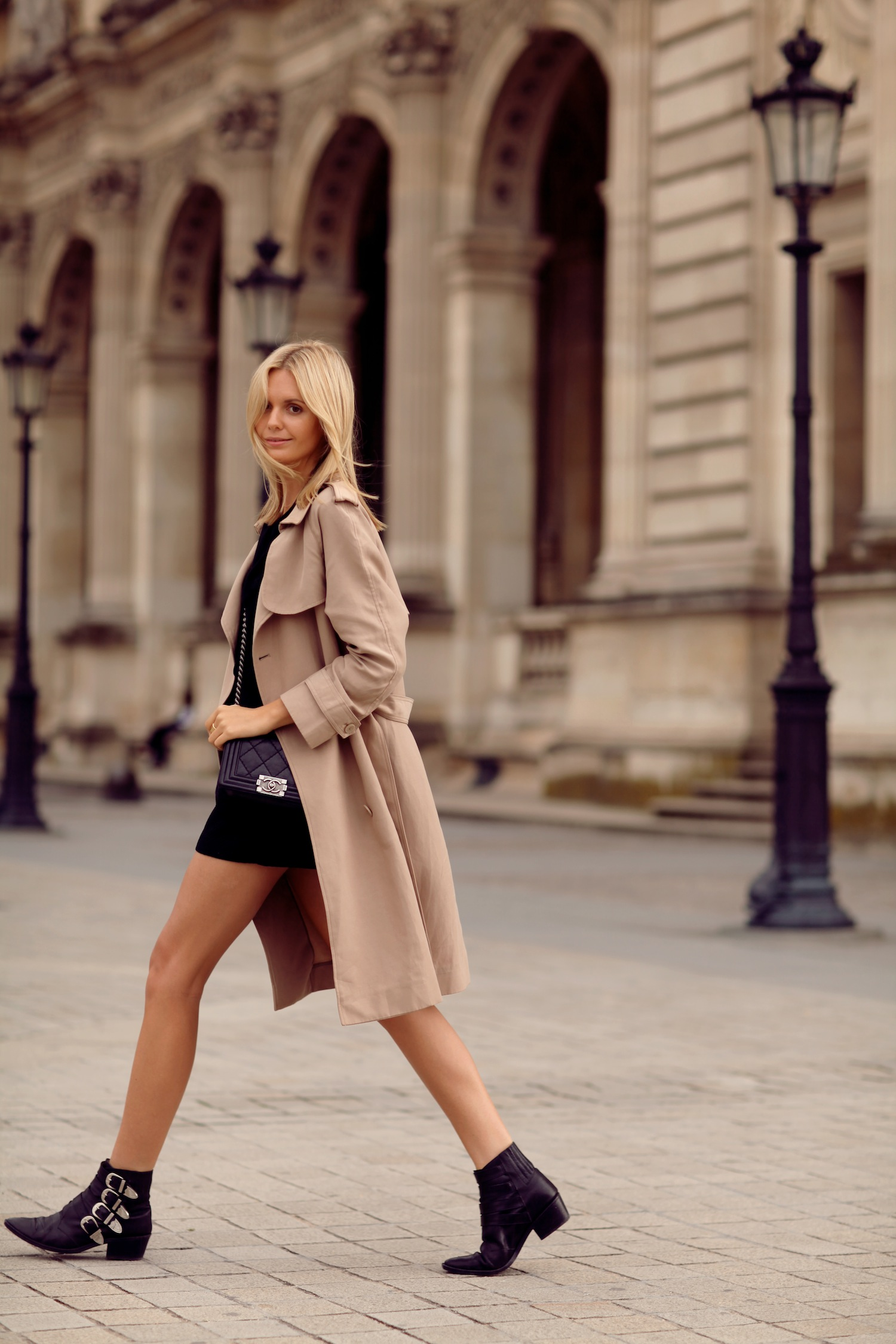 Jessica Stein is wearing a trench coat from Sportscraft, black blouse from Zara, matching shorts from Asos, ankle boots from Toga Pulla and a Boy bag from Chanel