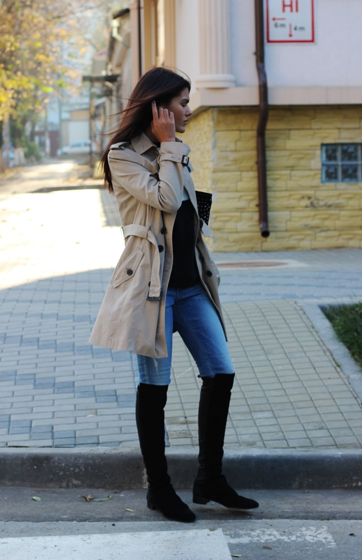 Mariana Stingaci in a trench coat from Mango, black jumper and boots from Zara and the jeans are from Calvin Klein