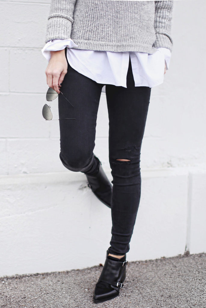 Mary Seng is wearing a black skinny jeans with ripped knees from DL1960