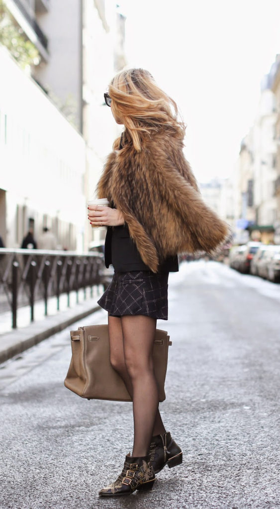 Studded Ankle Boots: Caroline Louis is wearing a bag from Hermès, geometric print shorts from Goodnightmacaroon, vintage faux fur jacket and the boots are from Chloé