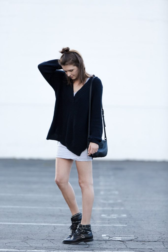 Rima Vaidila is wearing a deep V neck sweater from Silence + Noise