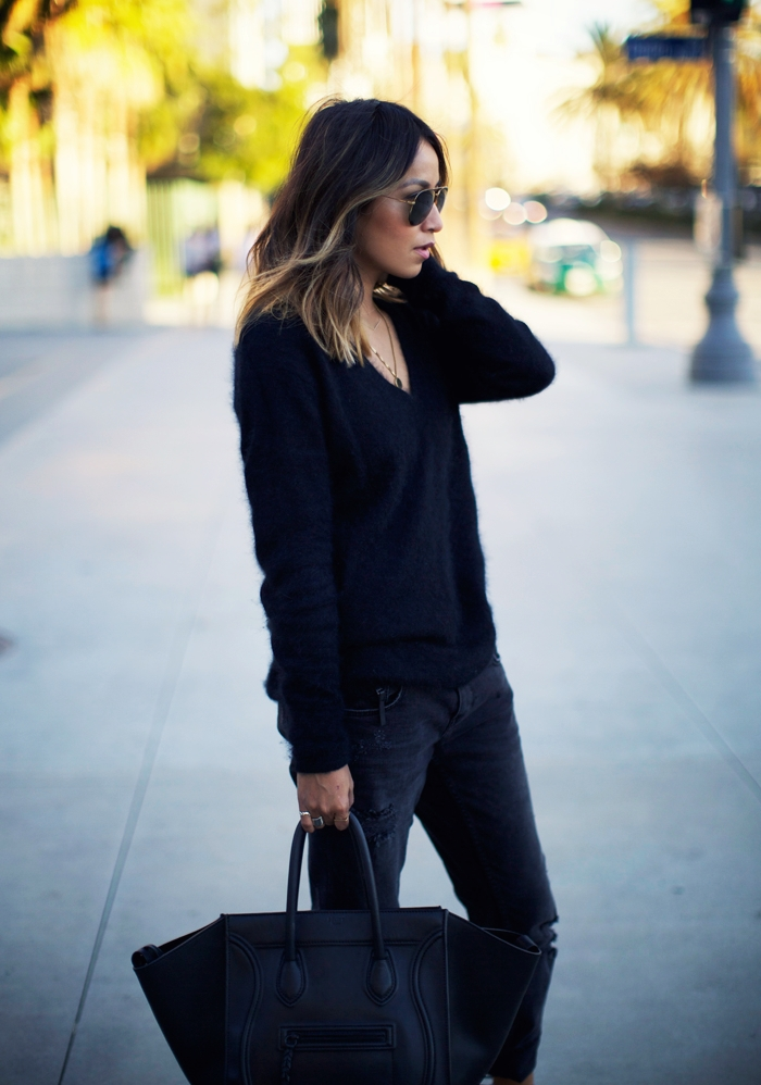 Julie Sarinana is wearing a black fuzzy angora V-neck from Maje