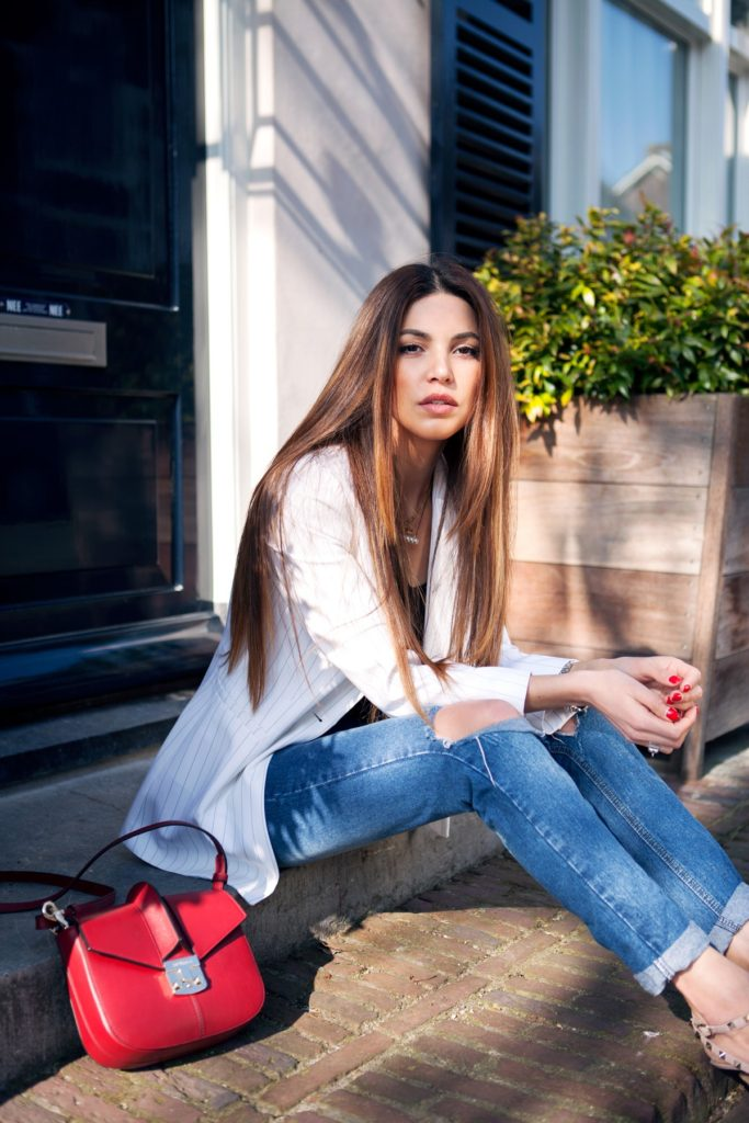 Negin Mirsalehi is wearing a white pinstripe Vanilia Classic jacket