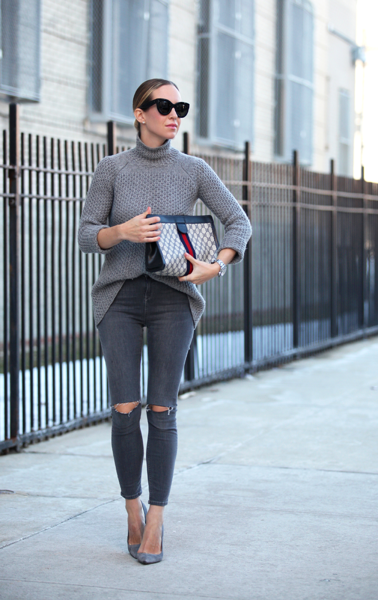 Helena Glazer is wearing a grey outfit with a knitted Zara sweater, ripped Topshop skinny jeans and Manalo Blahnik heels