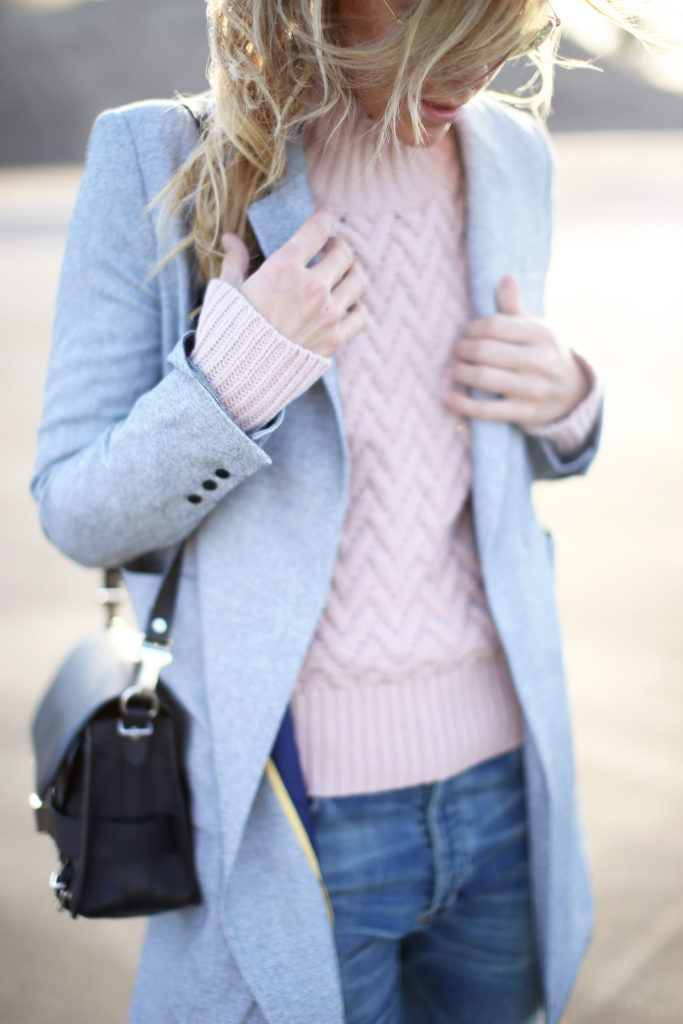 Pastel Outfits: Mary Seng is wearing a pink chevron pattern sweater from Vince Camuto and the pale blue coat is from McGinn