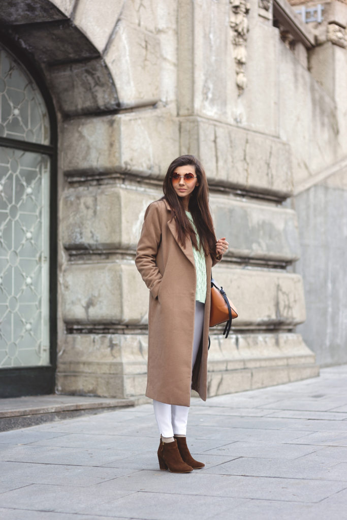 Larisa Costea is mixing in a mint coloured knit sweater from Romwe